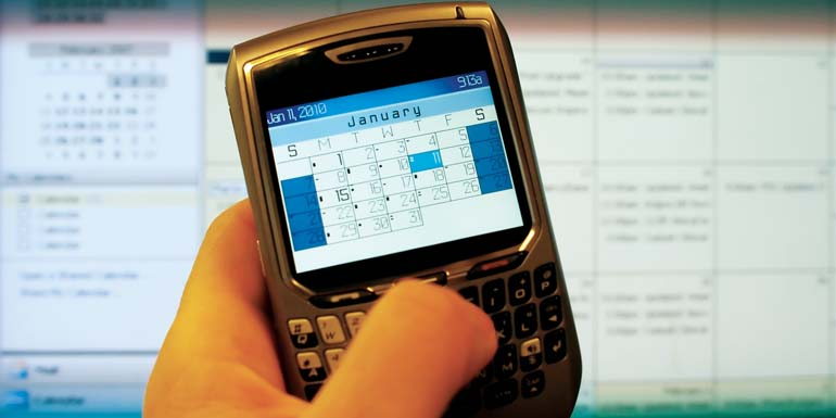 bigstockphoto_A_Handhold_Device_And_Calender_1211924_edited-1