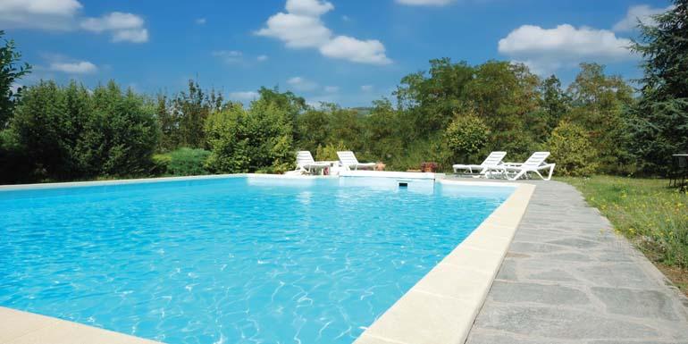 Swimming pool in the garden of an italian luxury villa, sunny day