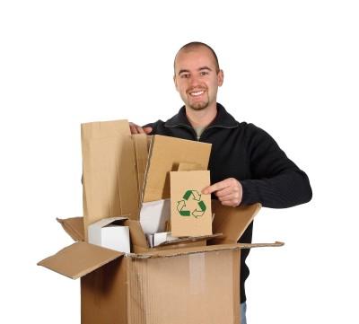 bigstock_Young_Man_Recycling_Cardboard_4118199