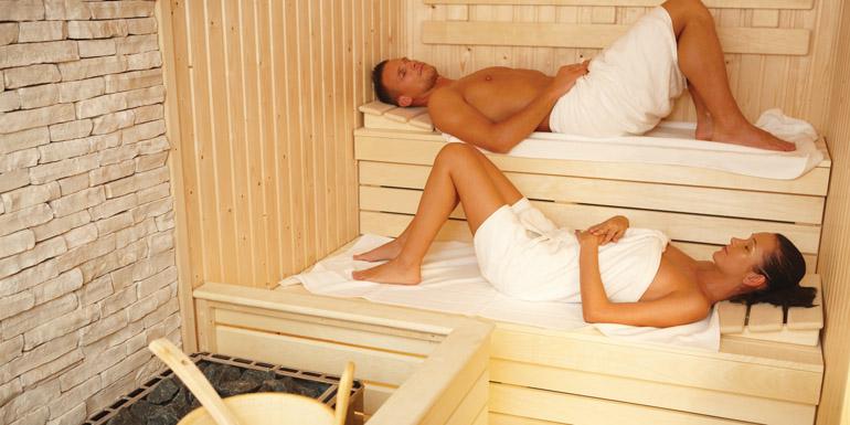 bigstock-Couple-lying-in-sauna-wearing--21521057_edited-1
