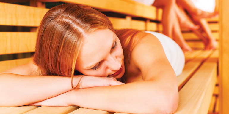 bigstock-Sauna-wellness--young-happy-w-32472683_edited-1