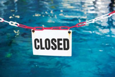 bigstock-white-sign-in-front-of-a-swimm-116276096