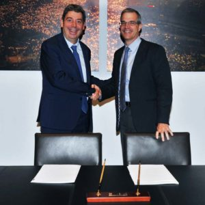 Fluidra and Zodiac executives shake hands and announce the merger of the two companies.