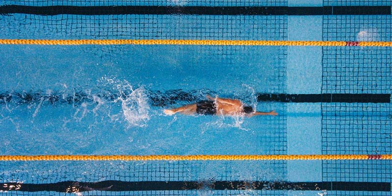 Swimmer in competition pool