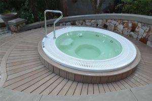 Composite deck built around hot tub