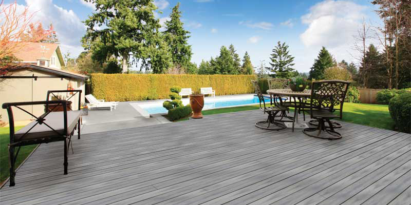 Composite pool deck surround in residential backyard