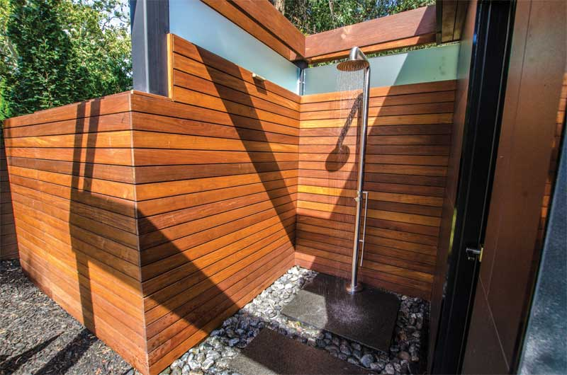 A private outdoor shower is attached to the cabana/bar.