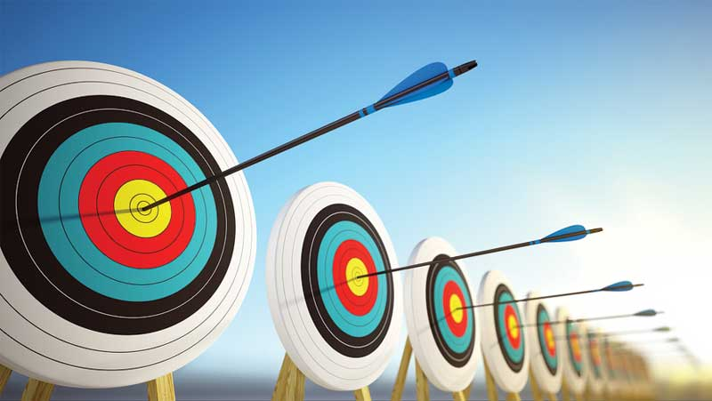 Archery targets with arrows in the bulls eye representing good communication skills