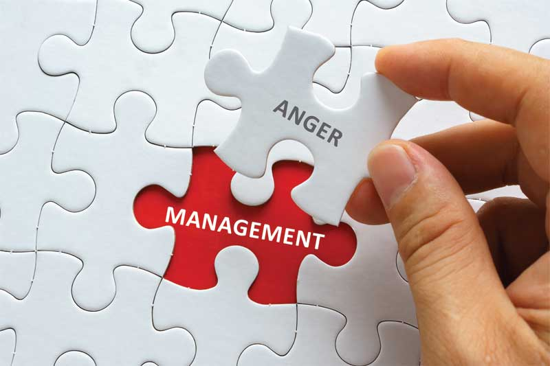 """Puzzle piece revealing words """"Anger Management"""" for communication skills"""