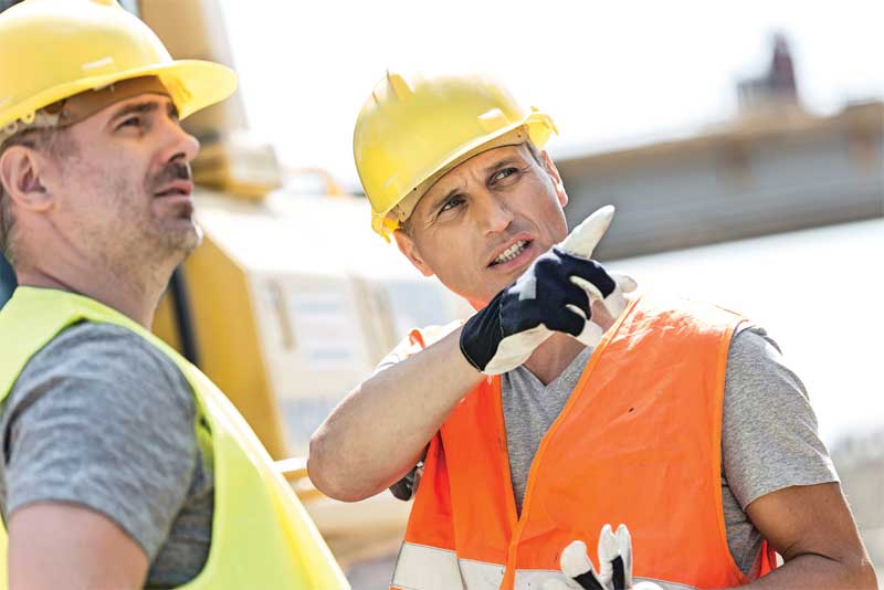 Two workers showing good communication skills