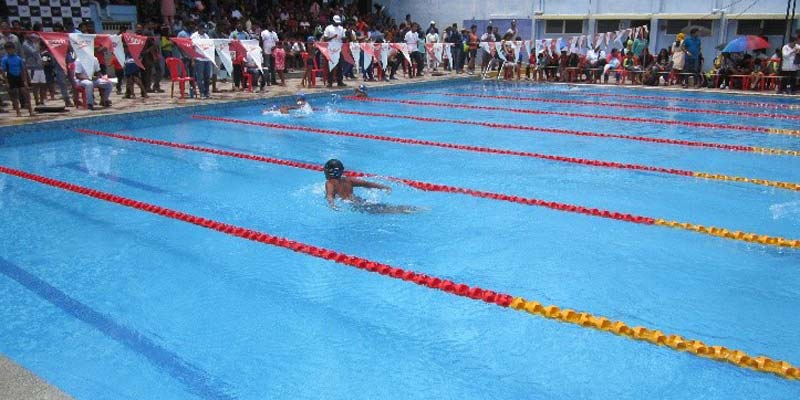Child swimming in pool as part of a learn to swim program
