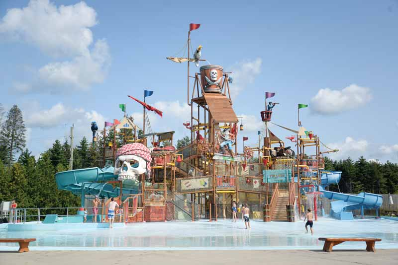 A multi-level waterpark play structure.