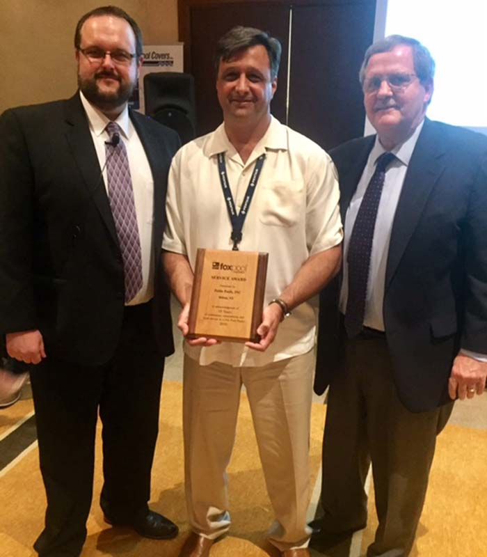 Fox Pool Corporation presents award to its oldest dealer