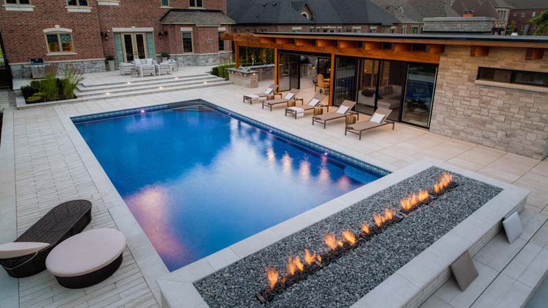 A 6.1- x 12.2-m (20- x 40-ft) vinyl-lined pool was installed as part of a collaborative feature project.