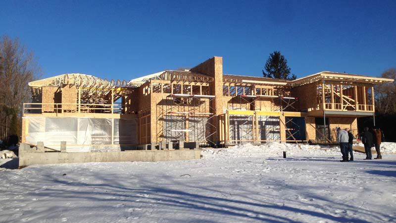 Construction of the residence began in the late fall (2015) and continued throughout the winter months, which included the pouring of the concrete foundation and traditional wood framing of the home's walls and roof.