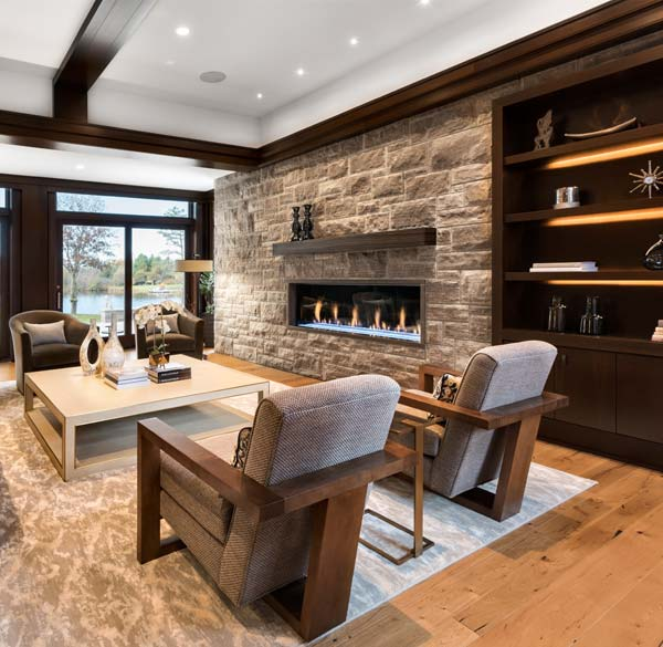 The design of the living room and its fireplace incorporates the same Eramosa limestone used to veneer sections of the home's exterior.