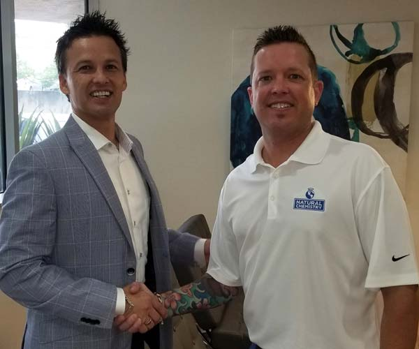 Premier Pool Service, the sister company of Texas-based pool builder, Premier Pools & Spas, has signed a partnership agreement with NC Brands. Pictured left to right are Charles Lauller, Premier Pool Service president and NC Brands regional manager, Ryan Rickaby.