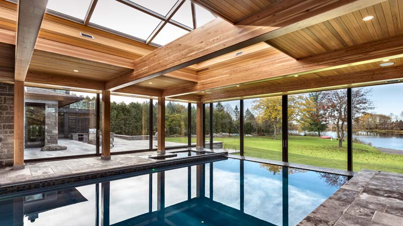 The design of the pool room blurs the boundary between the interior and the exterior spaces, creating an open-concept layout that gives the homeowner the feeling of always being outdoors.