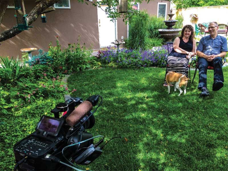Customer testimonial videos can be filmed in an interview format with the client in their backyard.