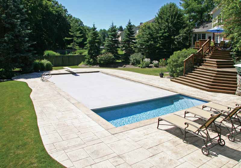 Automatic covers are now being designed to integrate perfectly with vinyl-lined pools.