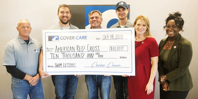 Cover Care's Dean Mikels, Jared Pepmeier, Darren Cardwell, and Mitch Valdez present the company's donation to Kate Hayward and Duchess Adjei of the American Red Cross.