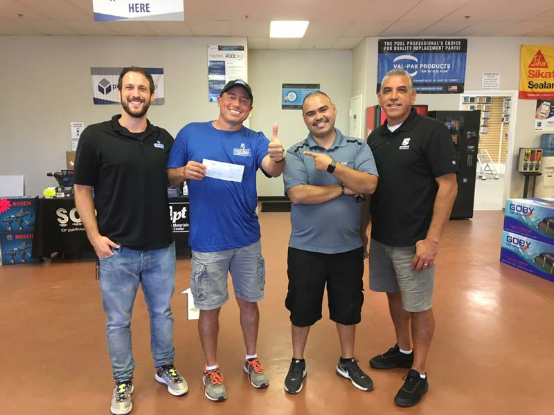 From left: Nick Gordon, NC Brands; first-place winner Tony Lawrence, TLC Pools; Jr., branch manager at Superior Pool Products El Cajon; and Gustavo, assistant branch manager at Superior Pool Products El Cajon.