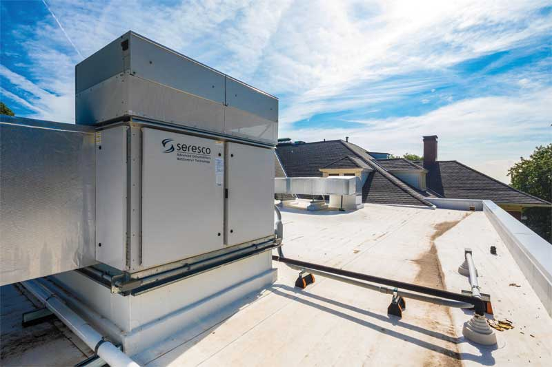 The heating, ventilation, and air conditioning (HVAC) equipment is anchored by a 16-ton dehumidifier, which is three-to-four times larger than a typical residential pool unit.