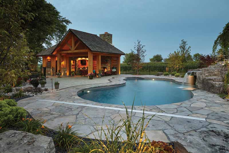 The outdoor living space was constructed using plenty of timber and stone.