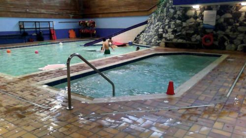earl mah aquatic centre. The 18-m2 (194-sf) wide skimmer whirlpool, with a volume of 10,834 L (2862 gal), was located in the middle of the building. It was built of concrete and finished with tiles. The current pool technology room is located behind the back wall of the pool.