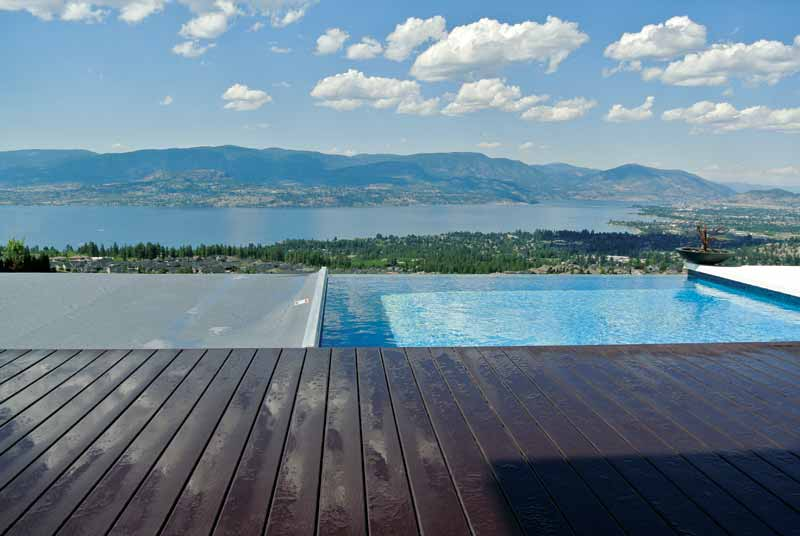 Infinity pools are built for their esthetic qualities, and an auto cover is the perfect complement to the clean lines of water falling over the edge of the pool.