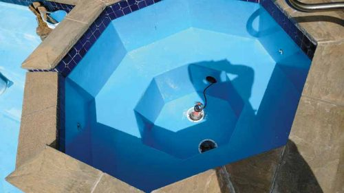 A two-coat epoxy paint system can prolong the life of the plaster, but only if the pool's surface is in good, sound condition.
