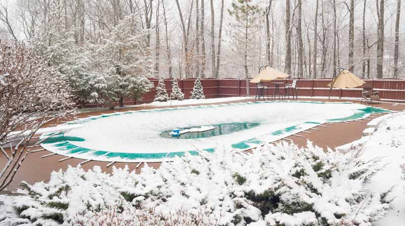 A sump pump should be employed to vacate any water accumulation on pools using a solid cover.
