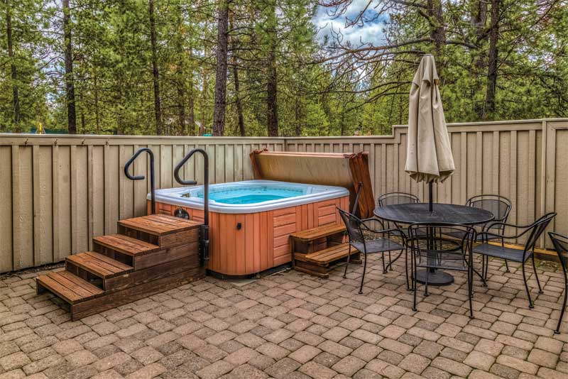 Many community bylaws also require hot tubs to be covered for safety reasons in regard to effective weight distribution and locking straps to prevent the cover from wear and tear during strong winds as well as unauthorized entry.
