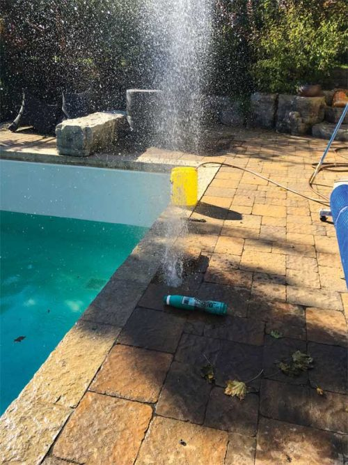 The pool's plumbing should be completely drained by using compressed air to blow out water from the recirculation system.