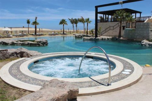 Additional features adjacent to the lagoon that use non-saltwater include a show fountain with 14 bubblers and  two spas—one on each end.