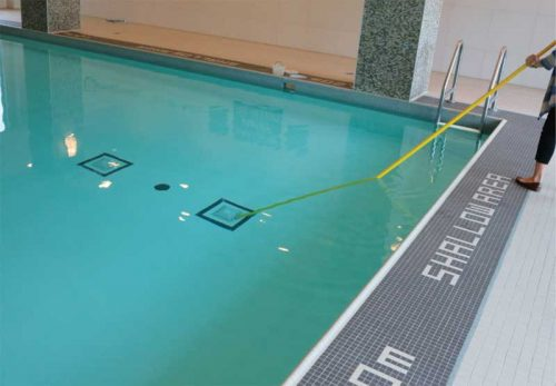 The pool's main drain covers (either side of the black disc) must be securely fastened and in good condition to prevent accidental entrapment. Also, the disc should be clearly visible from any point 9 m (29.6 ft) from the deck.