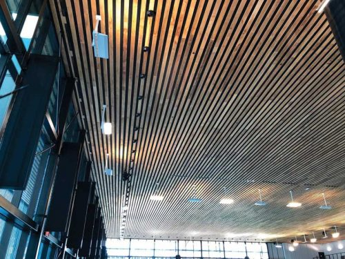 The project engineer and general contractor, Stantec, integrated the ducts into the building's cedar ceiling, with air nozzles projecting slightly from the surface to direct air into the breathing zone and along the windows.