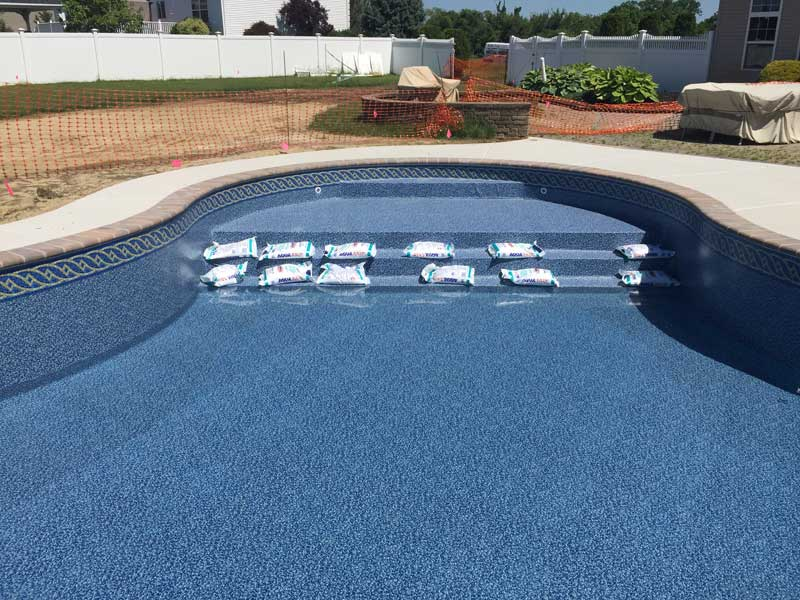 Vinyl-liner pools built with concrete walls can now support designs that include many features which, in the past, were typically associated only with custom gunite or shotcrete structures.